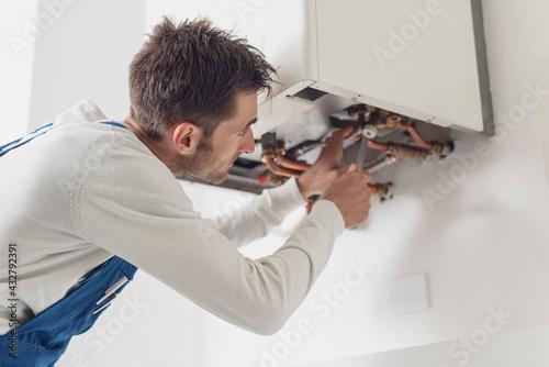 Fototapeta Professional plumber checking a boiler obraz