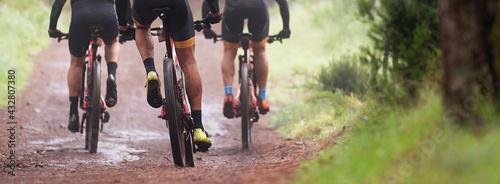 Mountain bikers riding on bike singletrack trail, mountain bike race