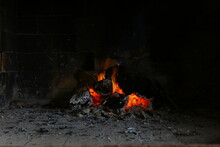 Firewood Burning In Old Fashioned Red Brick Fireplace.