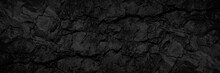 Rock Texture With Cracks. Black Stone Background With Copy Space For Design. Wide Banner.