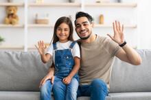 Family Laptop Waving Hands And Posing At Camera