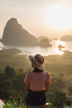 Young Woman In The Morning Sun Of Phang Nga Bay In Sametnangshe Viewpoint Of Phang Nga Province In Thailand.