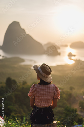 Obraz na plátně Young Woman in the morning sun of Phang Nga Bay in Sametnangshe viewpoint of Phang Nga province in Thailand
