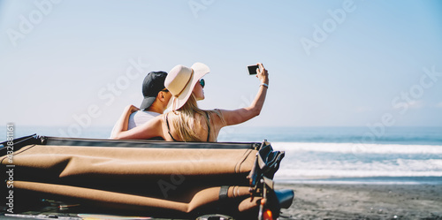 Fototapeta Young couple taking selfie near sea obraz