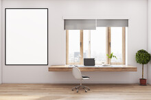 Blank White Poster In Black Frame On Light Wall In Stylish Home Office With Wooden Table Top, Green Tree In Brown Flower Pot, City View From Big Window And Eco Wooden Floor. 3D Rendering, Mockup