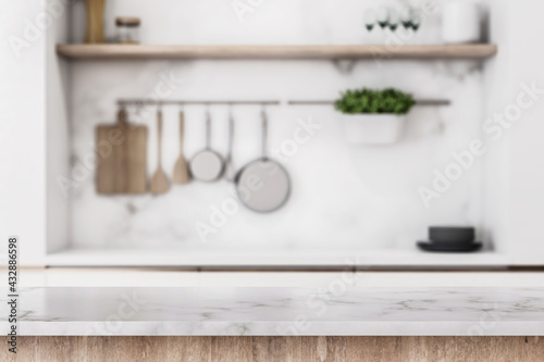 Fototapeta Stylish marble tabletop on wooden platform with copyspace for your logo at blurry kitchen utensils and dishes on light wall background. 3D rendering, mock up obraz