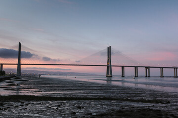 Amazing view of  Vasco da Gama Bridge at sunset. The Vasco da Gama Bridge crosses the Tagus River and is one of the longest bridges in the world. Lisbon. Portugal.