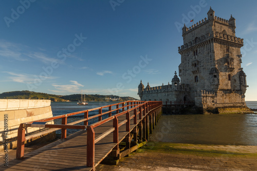 Belem Tower is a fortified tower on the Tagus river at sunset. Lisbon. Portugal. UNESCO World Heritage Site. Top tourist attraction in Europe. Concept of travel and tourism. #432891931