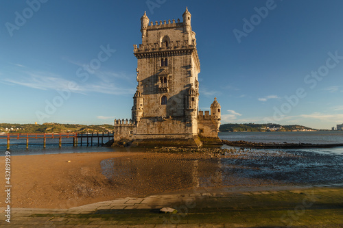 Belem Tower is a fortified tower on the Tagus river at sunset. Lisbon. Portugal. UNESCO World Heritage Site. Top tourist attraction in Europe. Concept of travel and tourism. #432891939
