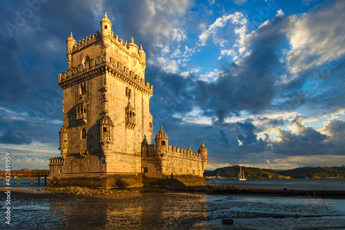 Belem Tower is a fortified tower on the Tagus river at sunset. Lisbon. Portugal. UNESCO World Heritage Site. Top tourist attraction in Europe. Concept of travel and tourism. #432891959
