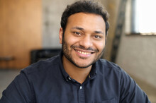 Cheerful And Serene Hindu Man In Smart Casual Shirt, Headshot Of Young Handsome Indian Guy, Handsome Mixed-race Male Looks At The Camera With Toothy Smile