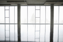 Empty Open Plan Office Space With Floor To Ceiling Windows