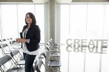 Portrait Confident Businesswoman At Creative Business Conference