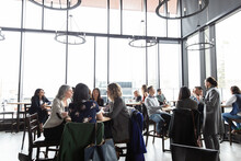 Crowd Of People Dining At Tables In Restaurant