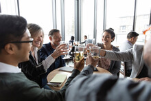 Happy Business Team Toasting Beer Glasses In Restaurant