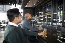 Businessmen Friends Drinking Beer, Watching Game At Sports Bar