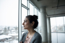 Ambitious, Thoughtful, Forward Looking Businesswoman Looking Out Empty