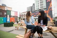 Real Estate Developers With Digital Tablet Talking At Urban Bazaar Mar