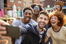 Diverse Enthusiastic Young Friends Taking Selfie With Camera Phone