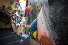 Colorful Climbing Holds On Wall In Climbing Gym
