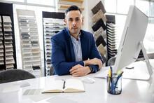 Portrait Of Interior Designer In Showroom Office