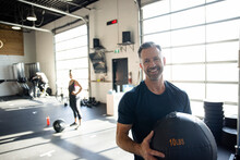 Portrait Happy Man With Medicine Ball In Cross Training Gym