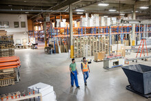 Workers Walking Together In Distribution Warehouse
