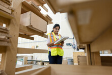 Supervisor Checking Building Materials In Distribution Warehouse