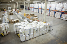 Distribution Warehouse With Products Stacked On High Shelves