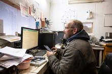 Farmer Working With Digital Devices In Office