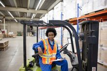 Portrait Of Forklift Driver In Distribution Warehouse