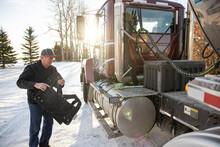 Driver Preparing Milk Tanker Truck For Milk Collection