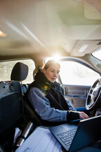 Woman Working With Laptop Inside Vehicle