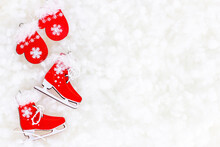 Flat Lay Bright Red Christmas Santa Claus Clothing And Skating Shoes On White Artificial Snow Background With Copy Space. Christmas And New Year Holidays Celebration Concept.