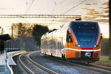 Express Orange Train. Estonian New Train. Ecological Passenger Transport, Fast Light Intercity And Regional Train.
