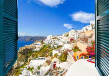 View Through An Open Window Of The Aegean Sea, Caldera And Town Of Oia With It's Blue Dome Church On The Island Of Santorini Greece.