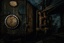 Old Rusty Vat And Pipes In Underground Basement