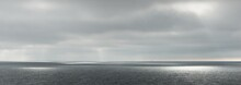 Panoramic View Of The Baltic Sea During The Storm. Dramatic Sky, Sun Rays Through The Dark Clouds. Epic Seascape. Finland. Concept Image, Ecology, Meteorology, Weather. Black And White, Silver Colors