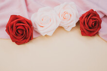 Closeup Of Red And Pink Roses On Pastel Background With Copy Space