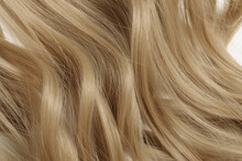 Closeup Texture Of Single Piece Clip In Wavy Honey Blonde Synthetic Hair Extensions