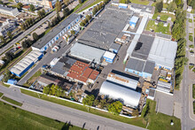 Aerial View Of Urban Industrial District With Warehouses And Industrial Buildings