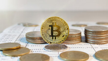 Golden Coins With Bitcoin Symbol On Bank Account Book, Coins Stack And Bitcoin.
