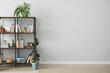Leinwandbild Motiv Shelf unit with books near light wall