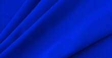 Smooth Elegant Blue Silk Or Satin Luxury Cloth Texture Can Be Used As Abstract Background. Crumpled Fabric Twisted At The Side
