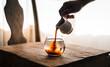 Leinwandbild Motiv hand of barista making ice coffee americano at home