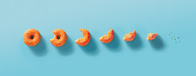 Seven Stages Of Donut Biting Or Eating Down To Crumb. Eaten Donut With Orange Glaze And White Sprinkles On Blue Background. Top View Or Flat Lay. Horizontal Banner