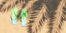 Flip Flops On Beach Sand With Palm Tree Shadow. Summer Time