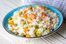 Delicious Vegetable Rice Pilaf With Green Peas, Carrots And Sweet Corn