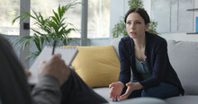 Young Woman Talking With A Professional Therapist