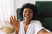 African Woman Waving Hand On Video Call